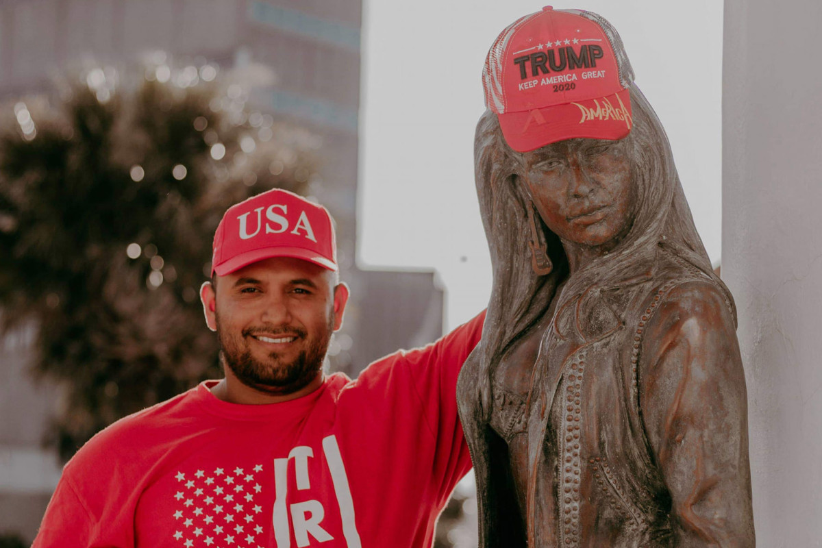 Selena fans angry after man puts MAGA hat on her statue